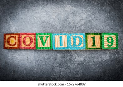 The epidemic of the covid-19 virus. Wooden cubes with letters.