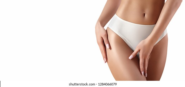 Epilation or Sugaring. Healthy Slim Body in White Panties. Beautiful Sexy Hips with Clean Skin. Fitness or Plastic Surgery. Perfect Legs without Cellulite. Copy Space with White Background