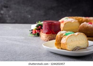 "Epiphany cake ""Roscon de Reyes"" slice on gray background. Copyspace"