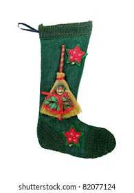 Epiphany sock decorated with broom and old woman's face.In Italian tradition an old woman (called Befana) fills socks with sweets for good children and with coal for bad ones on the 5/6 January night