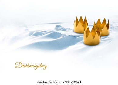 Epiphany, symbolized by tinkered crowns on a snowy background, german text Dreikoenigstag, that means Three King's Day