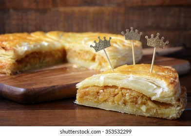 Epiphany Twelfth Night Cake, Almond Galette des Rois, Cake of the Kings, on dark wood rustic background.