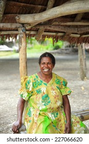 EPI,VANUATU-OCTOBER 4, 2014: Lady poses for tourists who photograph him in his stall on October 4, in Lamen Bay-Vanuatu.