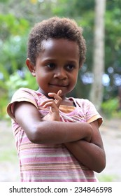 EPI,VANUATU-OCTOBER 4, 2014: Little girl little girl accompanies her mother selling crafts to tourists on October 4, in Lamen Bay-Vanuatu.