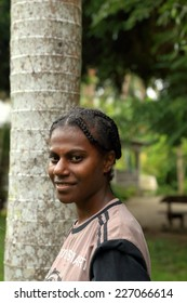 EPI,VANUATU-OCTOBER 4, 2014: Pretty girl poses for the photographer at the entrance to your home on October 4, in Lamen Bay-Vanuatu.