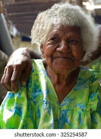 EPI,VANUATU-OCTOBER 5, 2014: Grandmother  at the entrance of her hut on October 5, in Nikaura-Vanuatu.