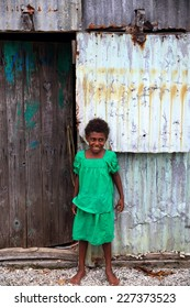 EPI,VANUATU-OCTOBER 5, 2014: Pretty unidentified girl poses for the photographer at the entrance to her home on October 5, in Nikaura-Vanuatu.