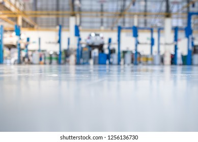 epoxy floor in interior car-care center. The electric lift for cars in the service