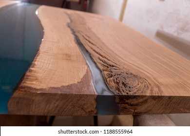 Epoxy resin in cracked walnut massif. Artistic processing of wood. furniture loft. modern furnishings. table-tops