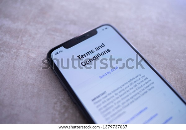 Eppelheim, Baden Württemberg / Germany - 04 24 2019 Apple Iphone XS Space Gray Close Up of Terms and Conditions Screen