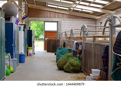 Eppelheim, Germany - July 2019: Inside of riding stable with empty horse stalls