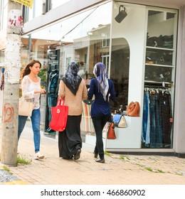 epublic of Macedonia, Ohrid,  Lake Ohrid, Struga,Struga situated in the south-western region of the Republic of Macedonia, lying on the shore of Lake Ohrid. Modern women shopping.  2015-09-21