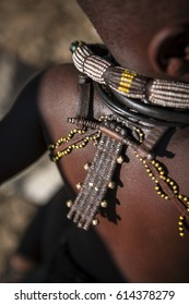 EPUPA, NAMIBIA - CIRCA JULY 2014 - A boy displays his traditional jewllery.Himba children are taught at a young age to take pride in their traditional adornments in an effort to preserve the culture.