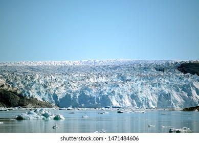 Eqip Sermia, Eqi Glacier in Greenland Disko Bay, Greenland - July - boat trip in the morning over the arctic sea - Baffin Bay - calving glacier eqi, world heritage, ice breaking of