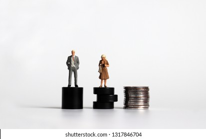 Equal labor equal pay concept. Miniature woman with a miniature man. #PayMeToo as social new movement.