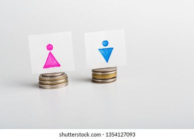 Equal Pay for man and woman, cards with gender figures and similar coin stacks, white background with empty space