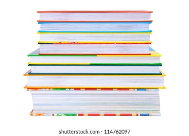 Equal pile of the bright color books isolated on white background