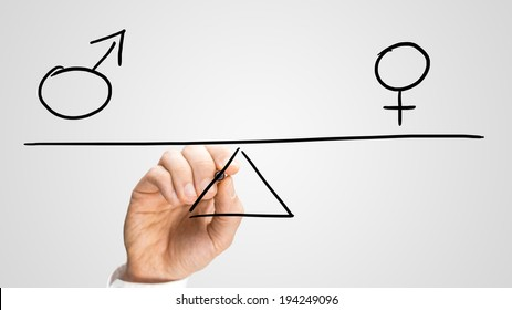 Equality between the sexes depicted in a conceptual image by a man drawing a seesaw showing the male and female genetic symbols in equilibrium.