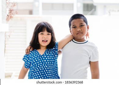 Equality and Racism.Asian kid girl and african american boy in school.Black lives matter no racism.Children with unity and friendship.Kids boy and girl.black lives matter for revolution protest.People