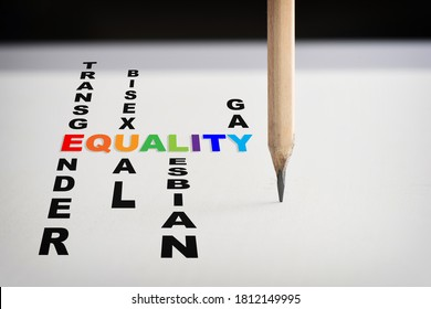 Equality, transgender, gay, lesbian, and bisexual words with pencil on white paper on black background. Social issue concept and lgbt idea