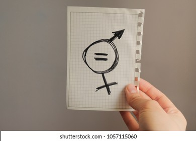 equals sign and a male symbol drawn on a piece of paper depicting the women sexual equality. gender equality drawn in it. fairness of treatment for women and men in the USA