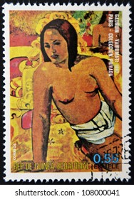EQUATORIAL GUINEA - CIRCA 1974: A stamp printed in Equatorial Guinea dedicated to the female nude in art history shows Vairumati by Paul Gauguin, circa 1974