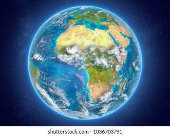Equatorial Guinea in red on model of planet Earth with clouds and atmosphere in space. 3D illustration. Elements of this image furnished by NASA.