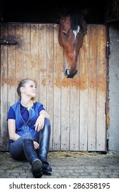 Equestrian girl and horse in stable