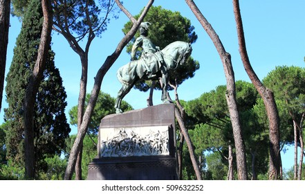Equestrian monument to King Umberto the First against the backdrop of majestic pine trees and blue sky. Villa Borghese. Rome. Italy. Summer.