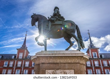 Equestrian monument of Philip III of Spain located on Plaza Mayor in Madrid, capital city of Spain, view with Butchery House building