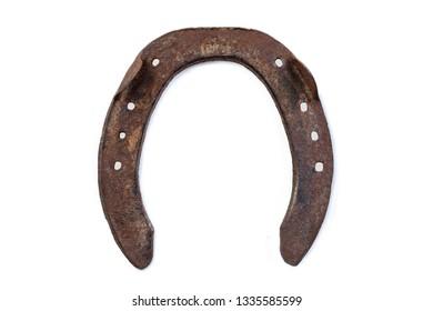 equestrian old equipment : Used horseshoe isolated on white background