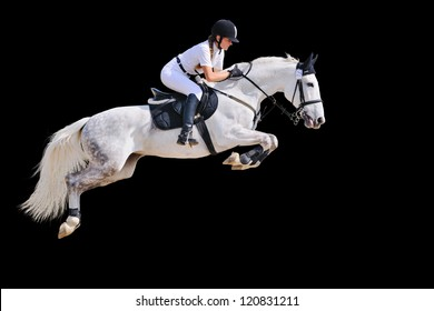 Equestrian sport: young girl in jumping show (isolated on black)