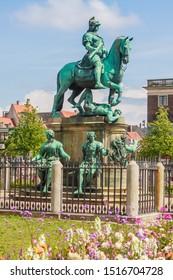 Equestrian statue of Christian V in the centre of Kongens Nytorv Nyhavn Copenhagen Denmark with flower arrangements