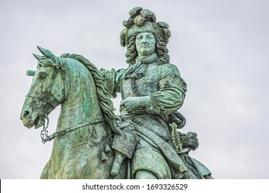 Equestrian statue of Louis XIV (Sun King) on the square in front of the palace of Versailles. Versailles, Paris, France.