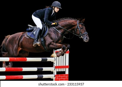 Equestrianism: Young girl in jumping show, isolated on black background