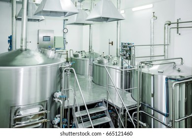 Equipment for the brewery. Large shiny tanks.