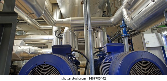 Equipment, cables and piping as found inside of a modern industrial power plant