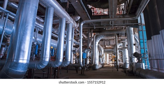 Equipment, cables and piping as found inside of  modern industrial power plant