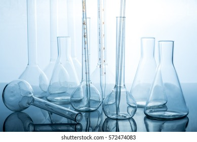 Equipment for chemistry experiments. Flasks and vessels in chemical laboratory table.