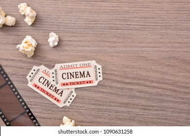 Equipment and elements of cinema detail on wooden table. Concept of watching movies. Horizontal composition. Top view.