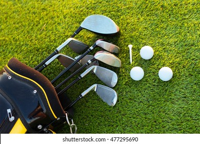 Equipment golf in bag on grass green background