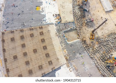 Equipment for installing piles in ground, heavy machines for driving pillars work in laying the foundation building. Construction aerial view height