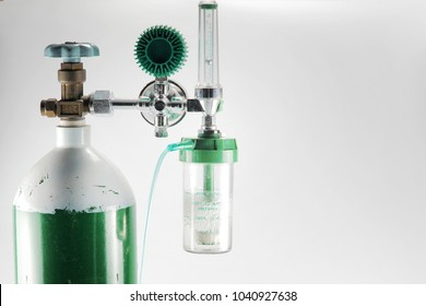 Equipment medical Oxygen tank and Cylinder Regulator gauge.Control pressure oxygen gas for care a patient respiratory disease and emergency CPR at Hospital, Close up focus on black background.