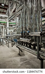 Equipment and piping as found inside of industrial thermal power plant.