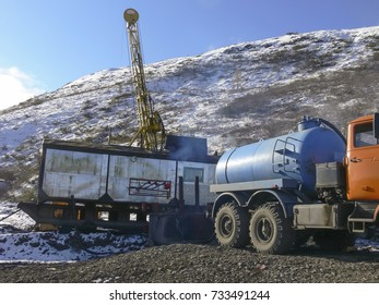Equipment in place of gold exploration. Caravan with a tower for drilling and coring. Vehicle with technical water.