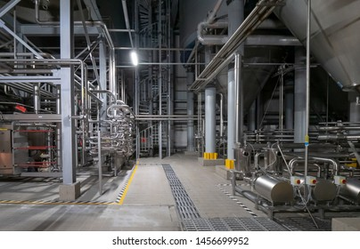 Equipment for preparation of beeer.Lines of metal tanks in modern brewery. Manufacturable process of brewage. Mode of beer production. Inside view of modern brewhouse with stainless barrels