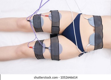 Equipment for slimming. Fat electrostimulation. Device women leg, stomach.