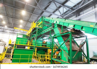Equipment for sorting household waste in a waste recycling plant. Modern technologies for waste disposal. View of the production hall from the inside
