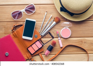 Equipment tour of the teen girl, cosmetics, accessories, make-up, the smart phone, bag, hat ready to travel.