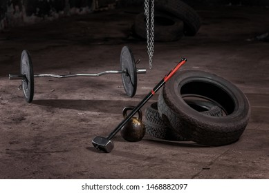 Equipment for training. Tires, hammer, kettlebell, weight.